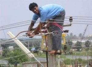 Man on a pilon - Health and Safety Risk